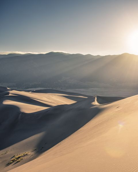 A silhouette of a person hiking at Great Sand Dunes National Park.