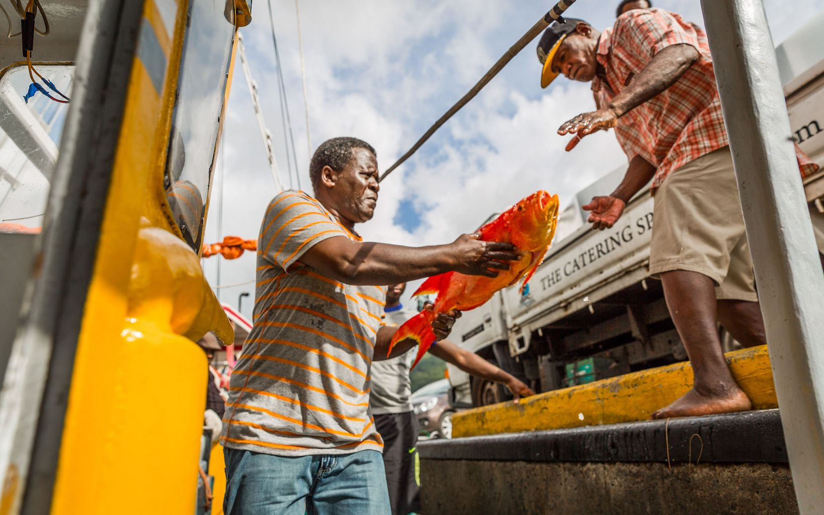 Jean de Dieu Leonel, captain of the Felicite, unloading unidentified bottom fish from the Felicite, Seychelles.
