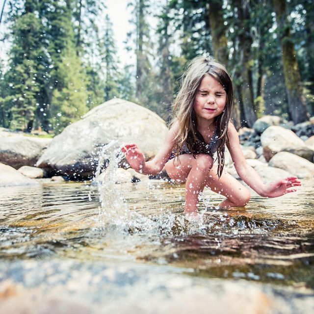 A child playing in the Marble Fork of the Kaweah River.