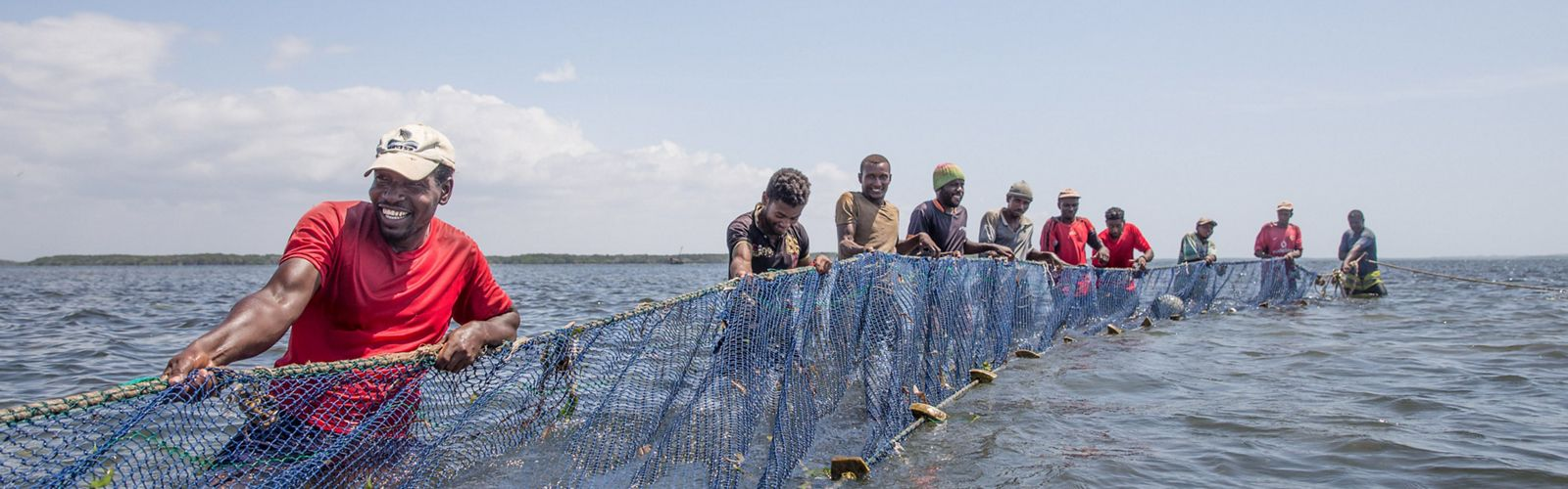 Fishermen from Pate Island in Lamu County pull a beach seine net in the Indian Ocean waters.