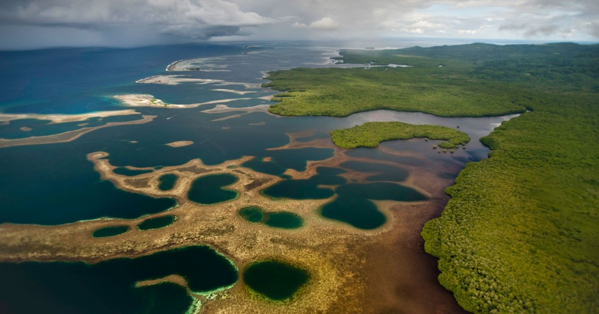 Aerial view of the Nahtik Marine Protected Area adjacent to the Enipein Mangrove Forest Reserve, Pohnpei, Micronesia.