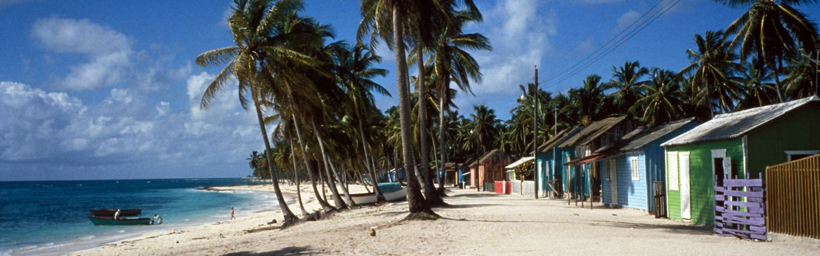 Colorful houses line the beach on Saona Island, Parque Nacional del Este, Dominican Republic.