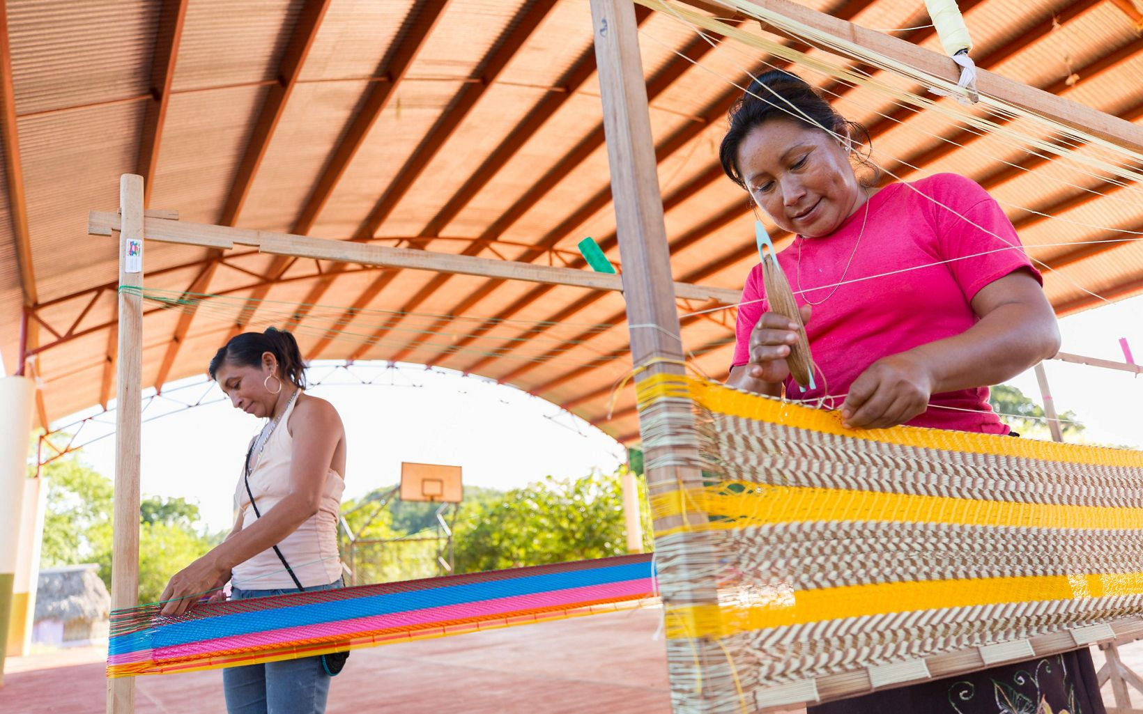 Women from the San Agustin ejido cooperative weaving traditional Mayan hammocks to sell in Merida near San Agustin, Yucatan.
