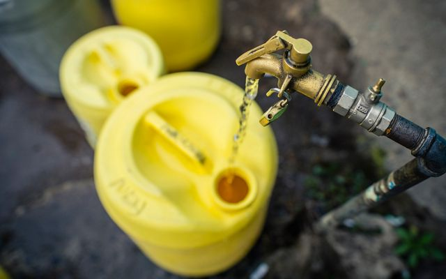 A water spigot in Nairobi used for filling up containers to deliver water to residents and businesses because Nairobi lacks reliable water supply, Kenya.