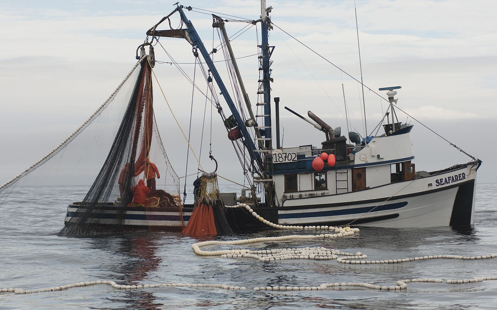Hauling seine nets on a commercial salmon fishing boat along the coast of Prince of Wales Island in Southeast Alaska.