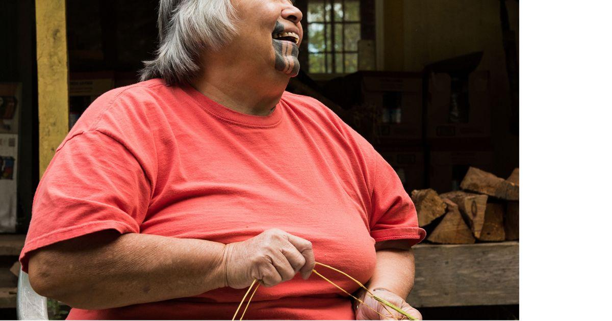 A Yurok tribal elder demonstrates basket weaving