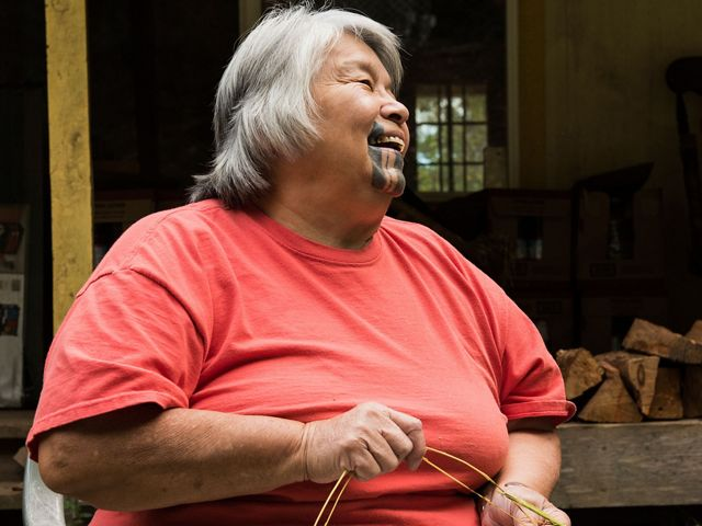 A Yurok tribal elder demonstrates basket weaving