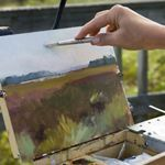 An artist painting ouside