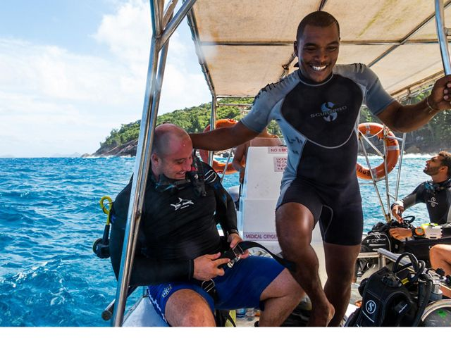 Grandy Fauchette, Dive Master at Dive Resort Seychelles on Anse á la Mouche, Mahé Island with his clients.