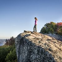 A hiker enjoys the scenic view of Bad Branch State Nature Preserve in Kentucky.