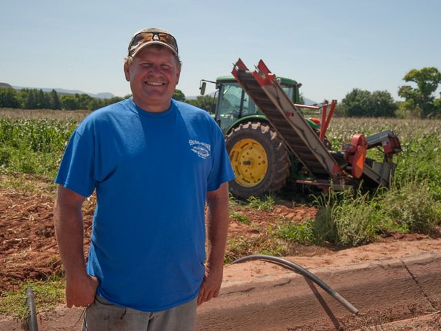 Kevin Hauser irrigates his grain and vegetable crops with water from Arizona's Verde River.