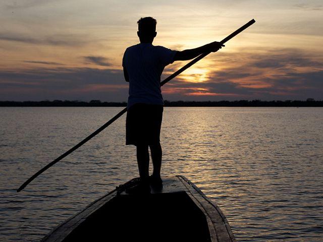 Fisherman sailing along the Magdalena River