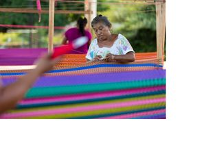 Woman weaving traditional Mayan hammock