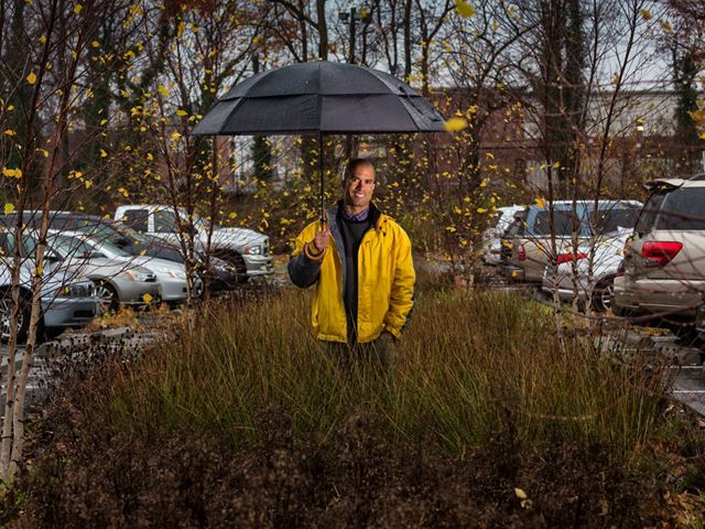 Urban Program Director of TNC's Maryland/DC chapter in the parking lot of the First United Methodist Church of Hyattsville, MD. it is the site of a stormwater runoff project.