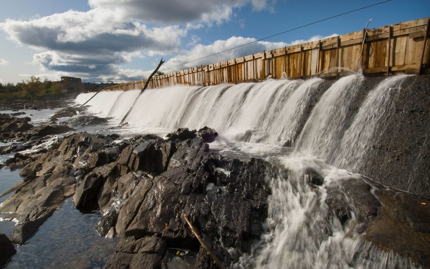 A portion of the old Howland Dam on the Penobscot River to be removed in Howland, Maine.