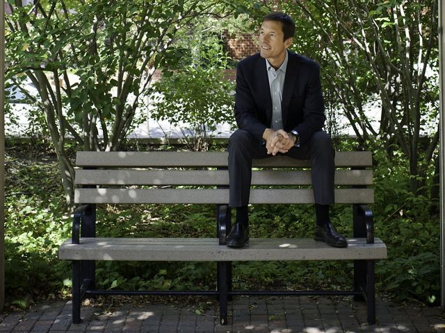 Mark Tercek sitting on the back of a bench