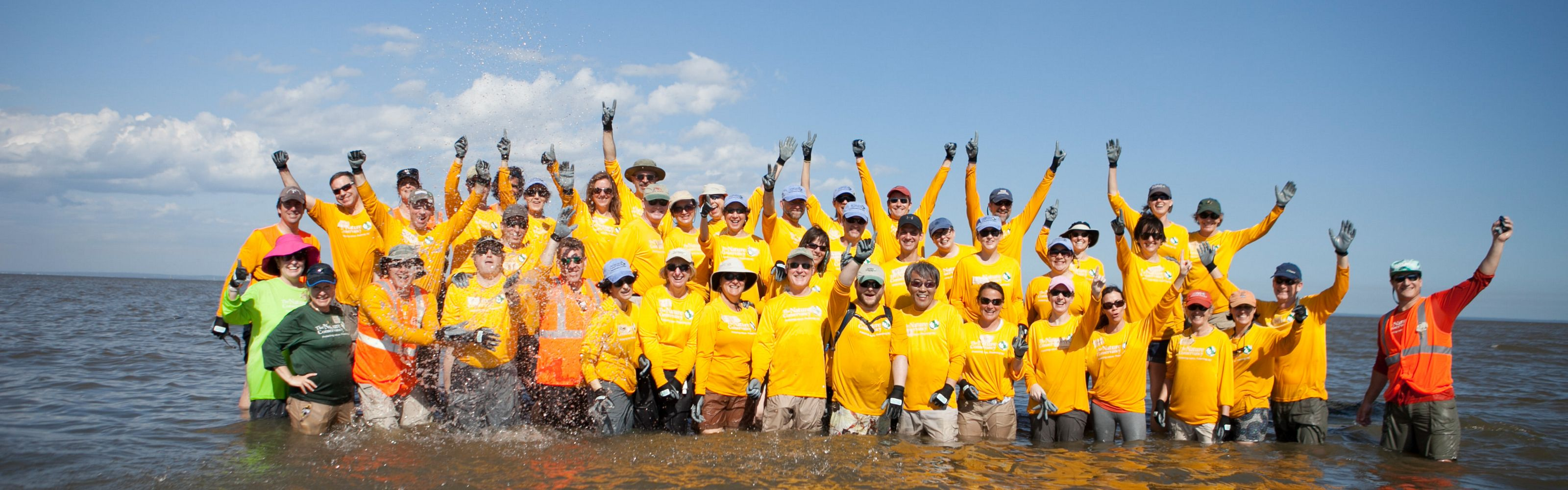 TNC Senior Leaders work together to build five reef structures at Arlington Cove in Mobile Bay, Alabama