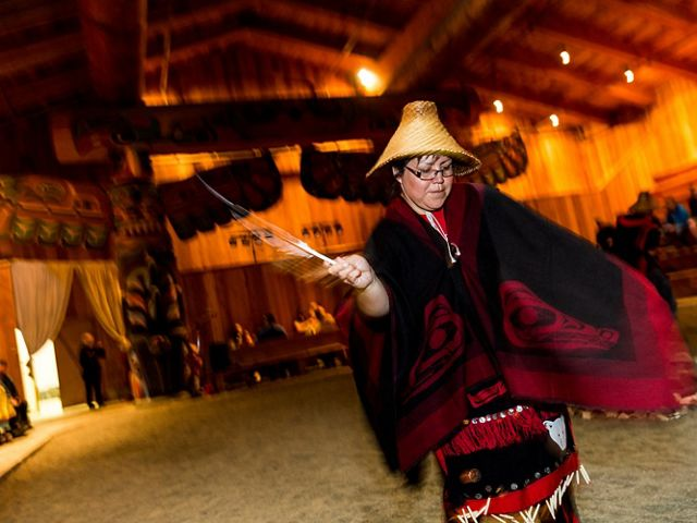 A First Nations woman dances in a cultural center in Klemtu, Canada