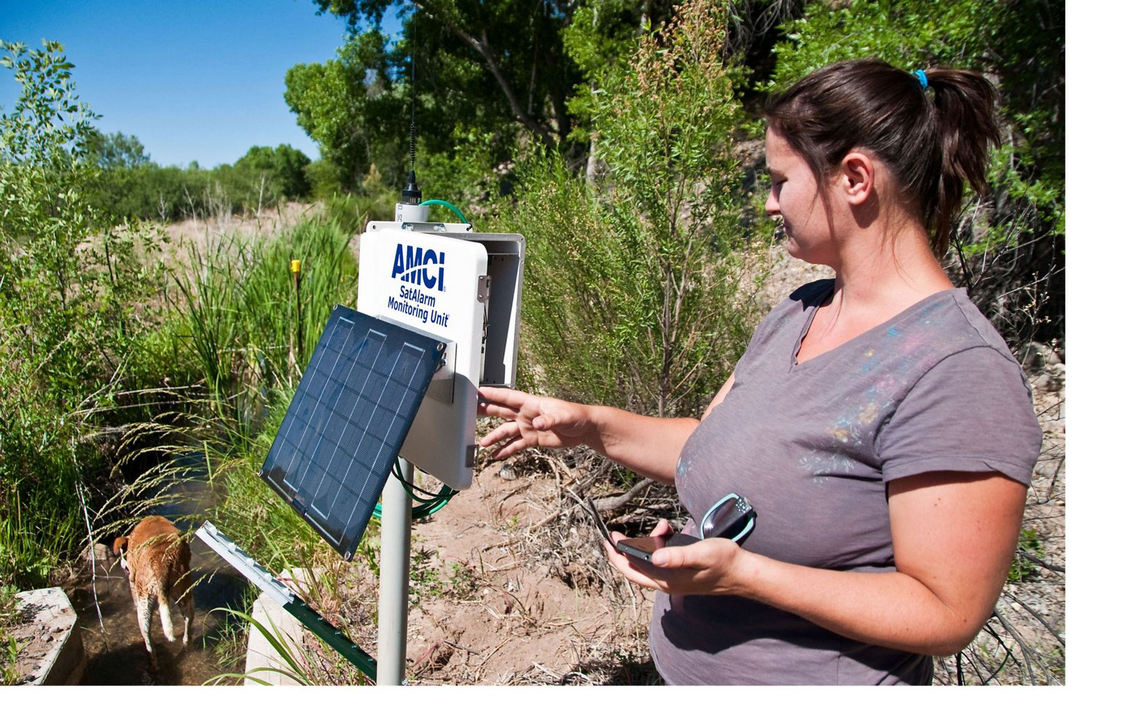 (INTERNAL RIGHTS) – Photo of Eurika Irrigation Ditch with Kim Schonek, TNC Verde Projects manager, checking gauge on the Shield Ranch. A portion of the system supplied by the Verde River.  Image size: 9.4 x 14.29 inches at 300 dpi. Photo credit: © Stephen Trimble