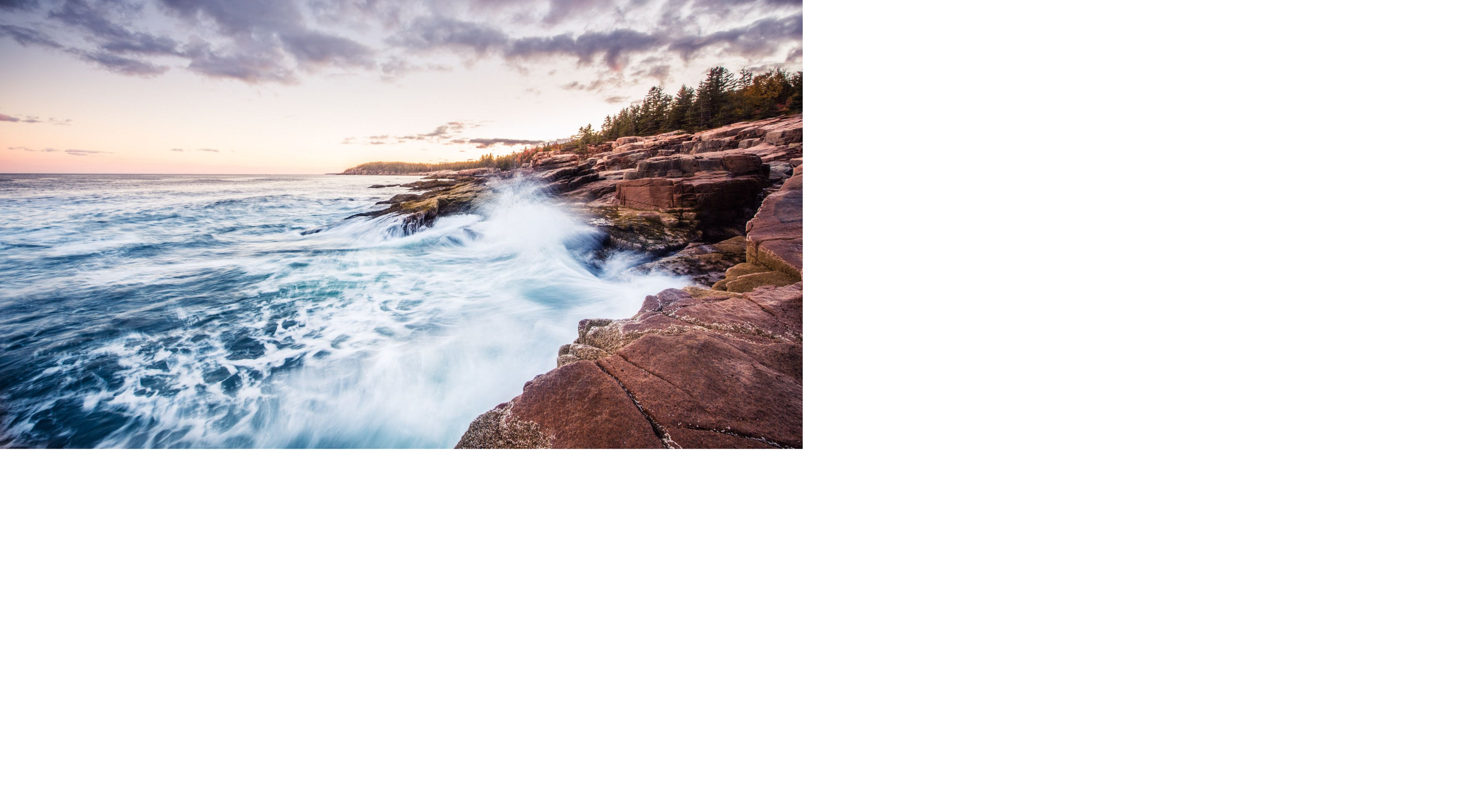 (ALL INTERNAL RIGHTS & LIMITED EXTERNAL RIGHTS) October 2015. Waves crashing against the rocky coast of Acadia National at sunset in Maine. The park service and vistor's celebrate 100 years of parks in August 2016. Photo credit: © Nick Hall