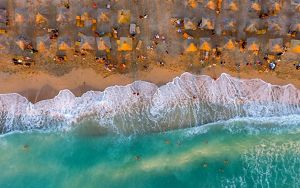 Aerial view of a village along a beach