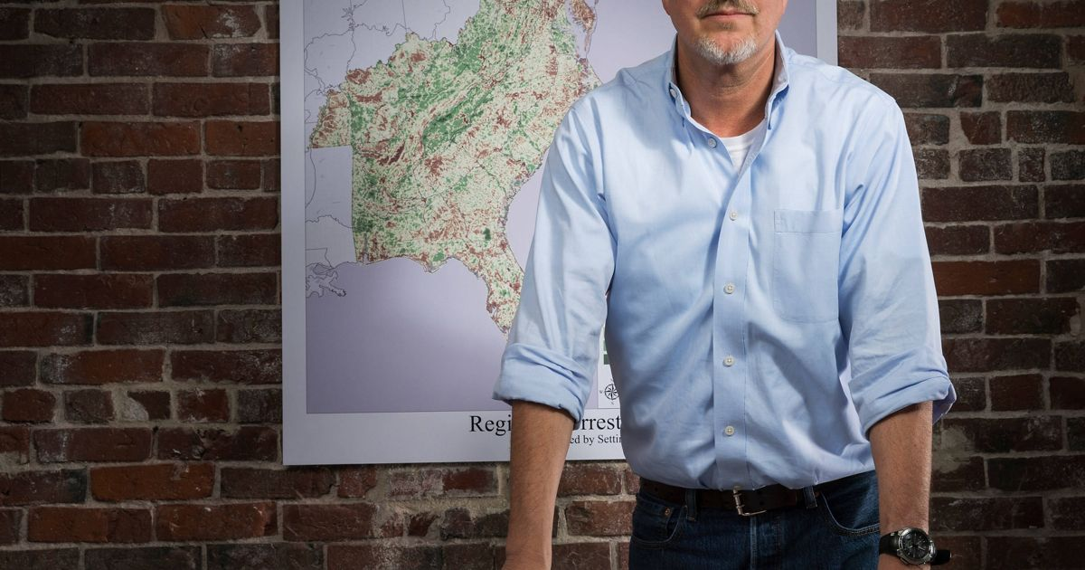 Portrait of Mark Anderson with map in background
