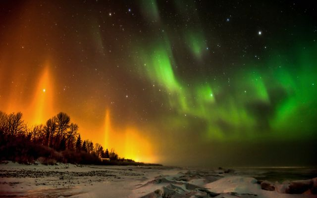 Northern lights glowing orange and green