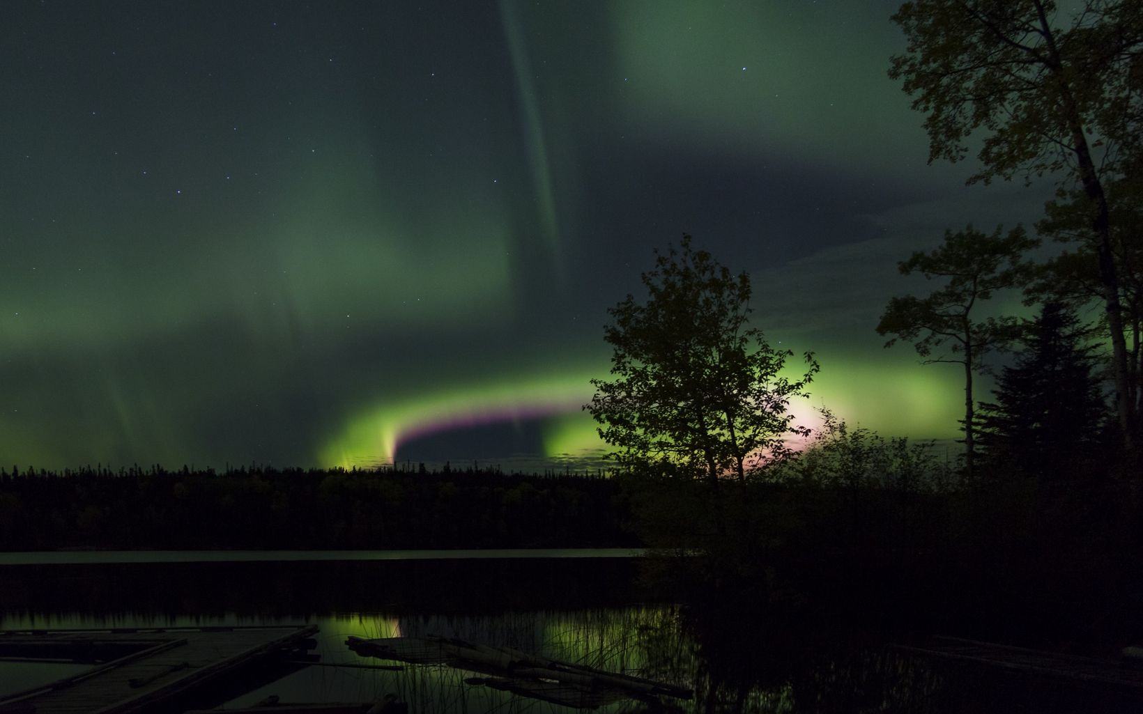 A vibrant display above the Kenanow Lodge in Sherridon, Manitoba, within the heart of Canada's boreal.