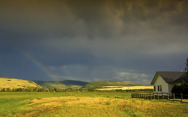 A scenic shot of TNC's Carpenter Ranch with a rainbow feature.