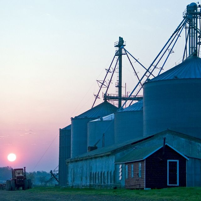 Sun sets behind grain silos in Maryland