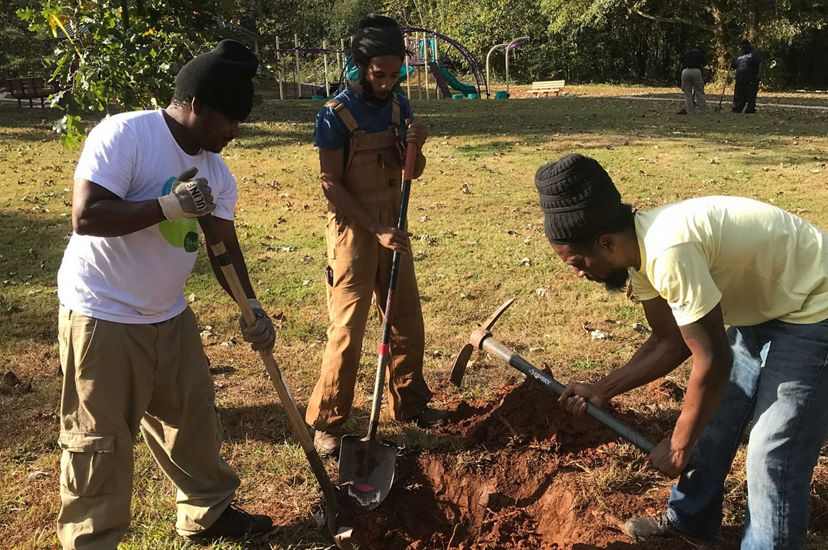 Urban Green Jobs trainees planting trees in their southeast Atlanta community.