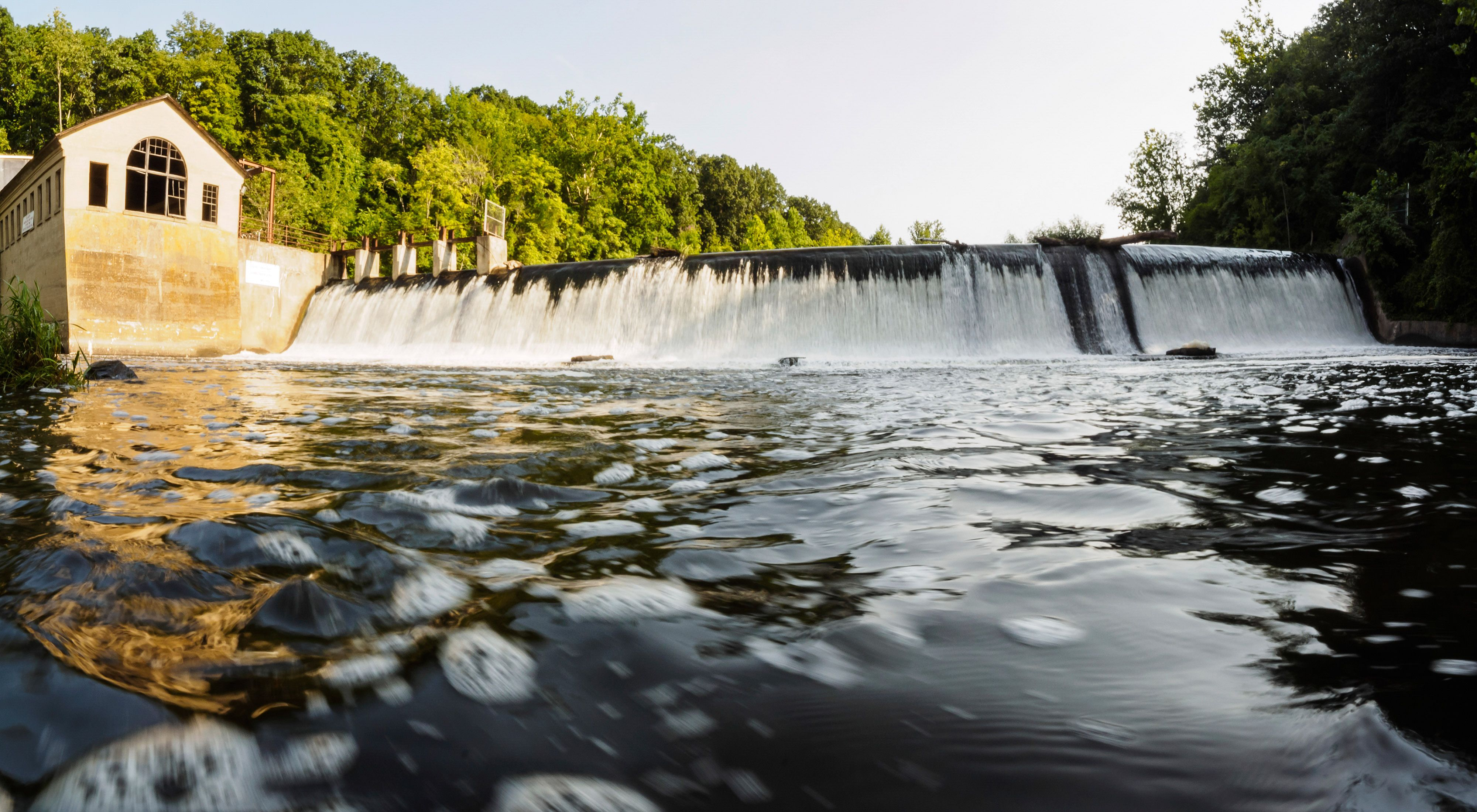 The Columbia Lake Dam  created an 18-foot high barrier for migratory American shad swimming in from the Delaware River to spawn in the Paulins Kill's calm waters.