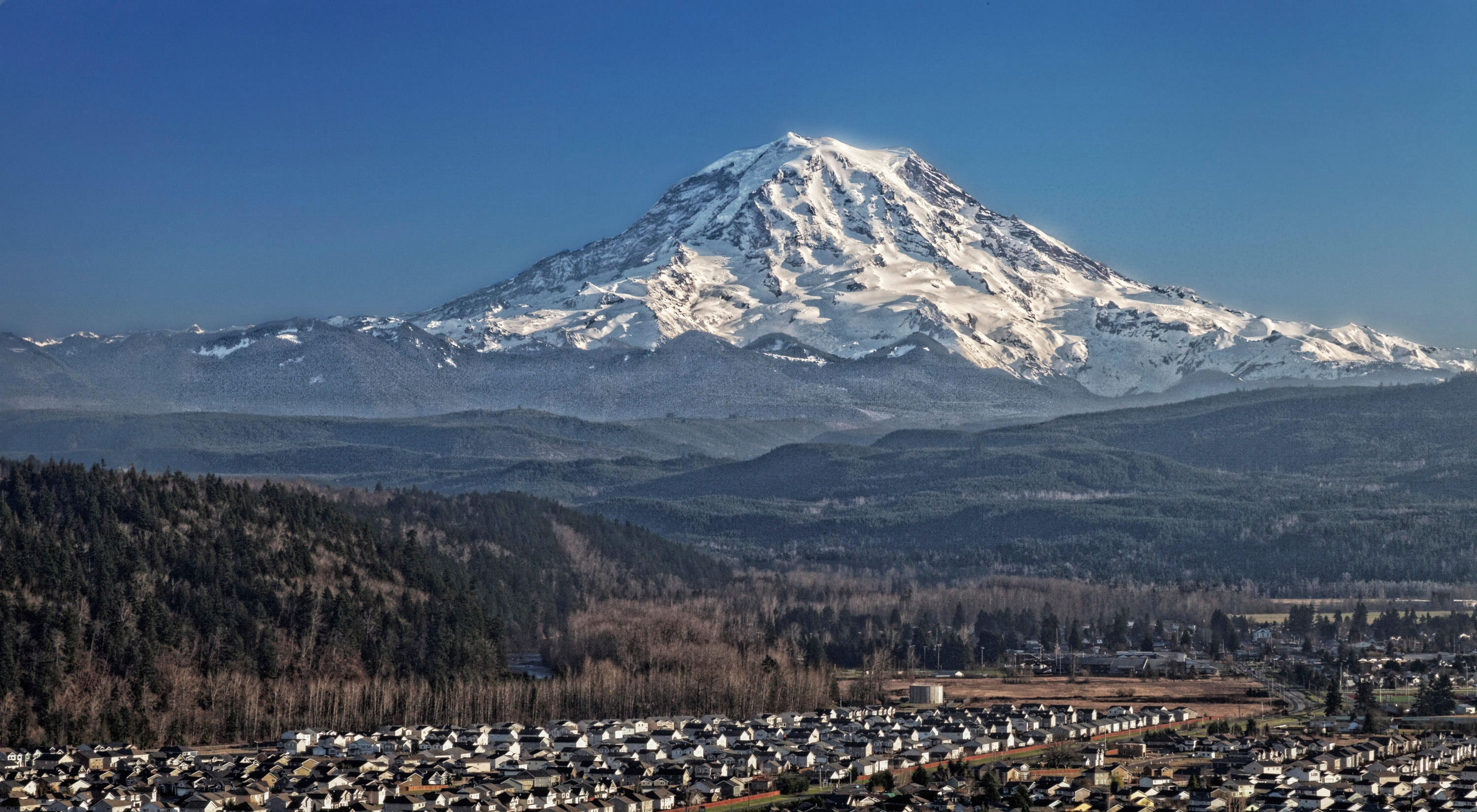 Mount Rainier looms over the Puyallup Valley, Washington.