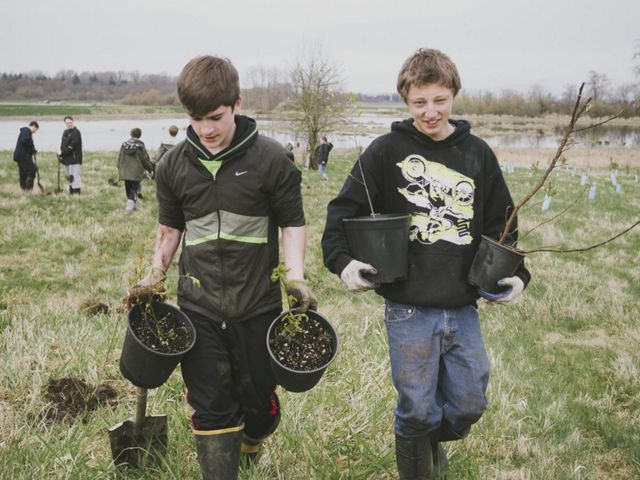 help restore trees at Fisher Slough.