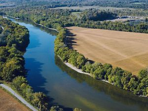 Wabash River flows past farm fields in Indiana.