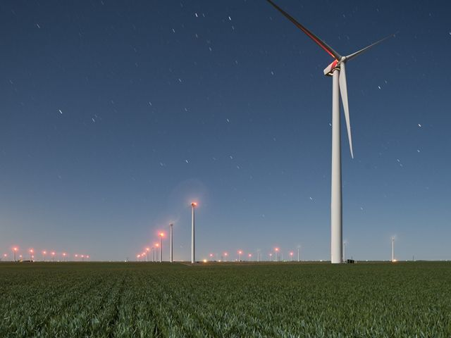 Rows of wind turbines across a Kansas farm create responsible and renewable wind energy.
