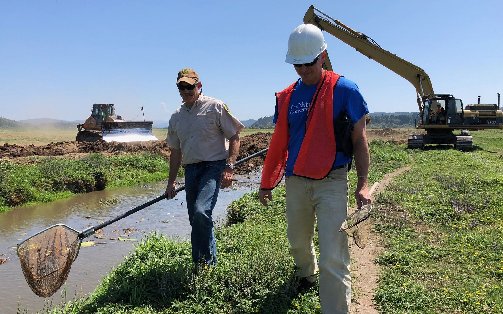 The Nature Conservancy's Jason Nuckols surveys the project site with Oregon Department of Fish and Wildlife's Stuart Love.
